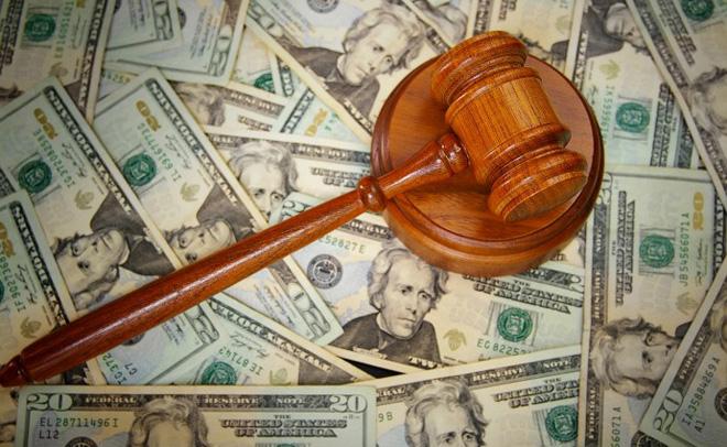 court gavel on U.S. Twenty dollar bills