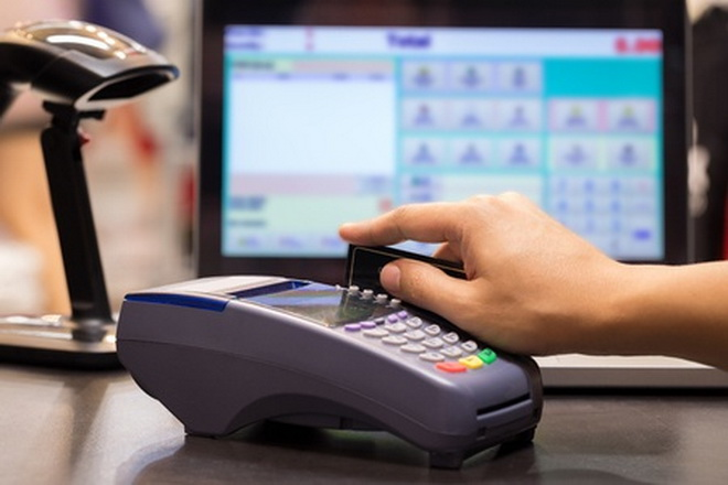 47838862 - hand swiping credit card in store